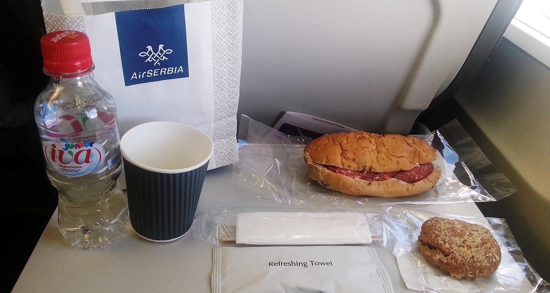 Air Serbia economy class sandwich and hot drink