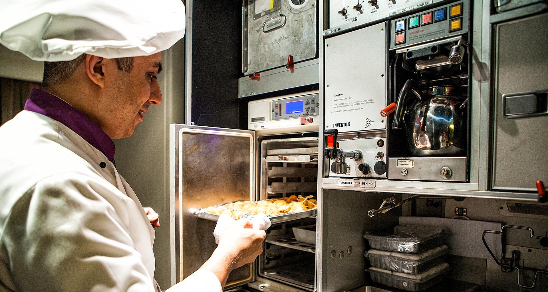 Turkish Airlines Inflight Chef prepares dishes in oven