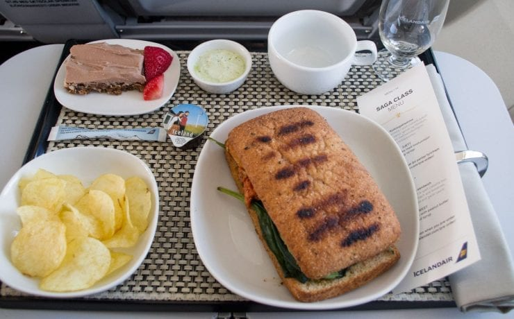 Icelandair business class meal, raw food cake, chips and toasted focaccia.