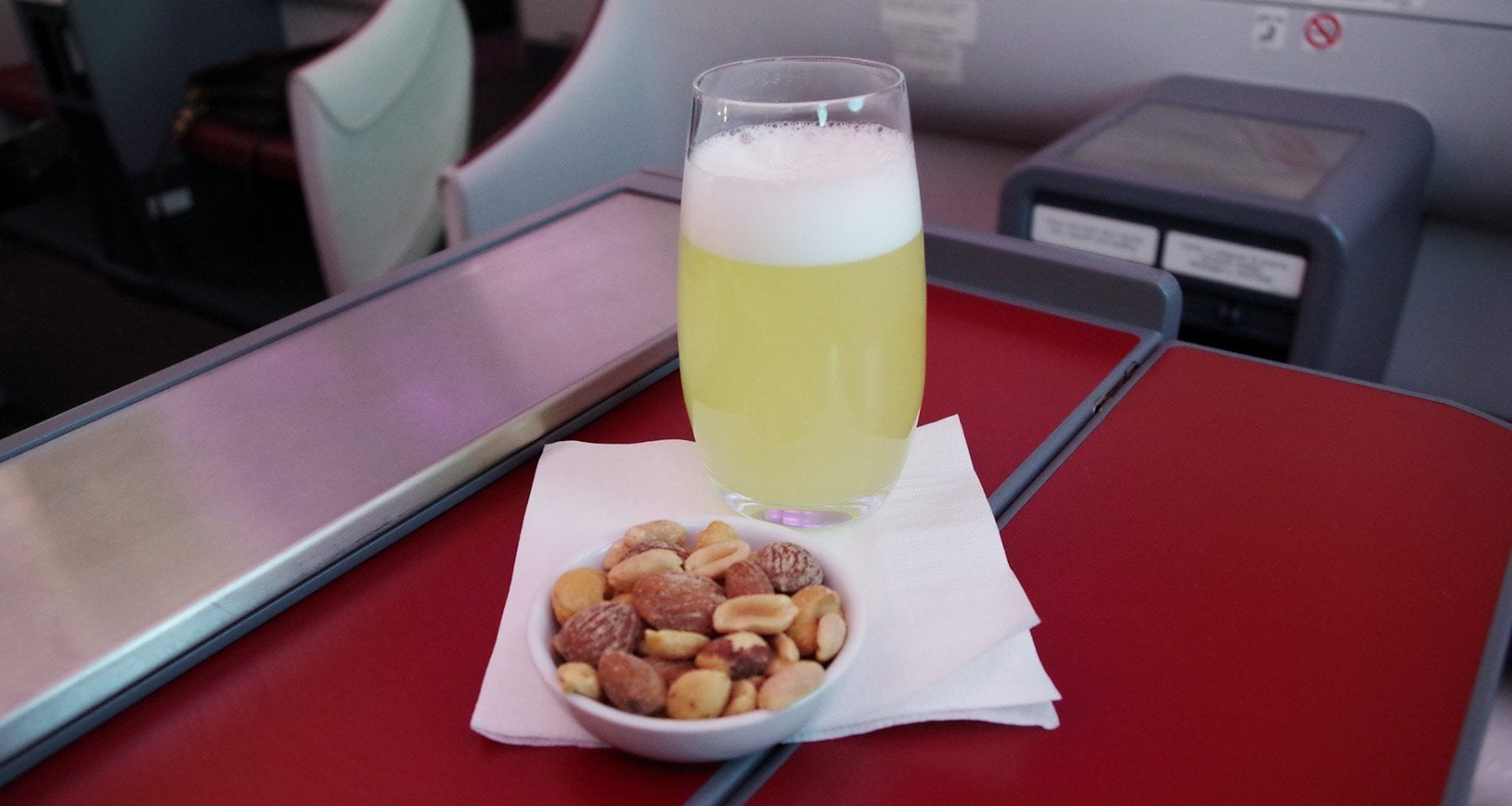 Lan Chile Pisco Sour and assortment of nuts