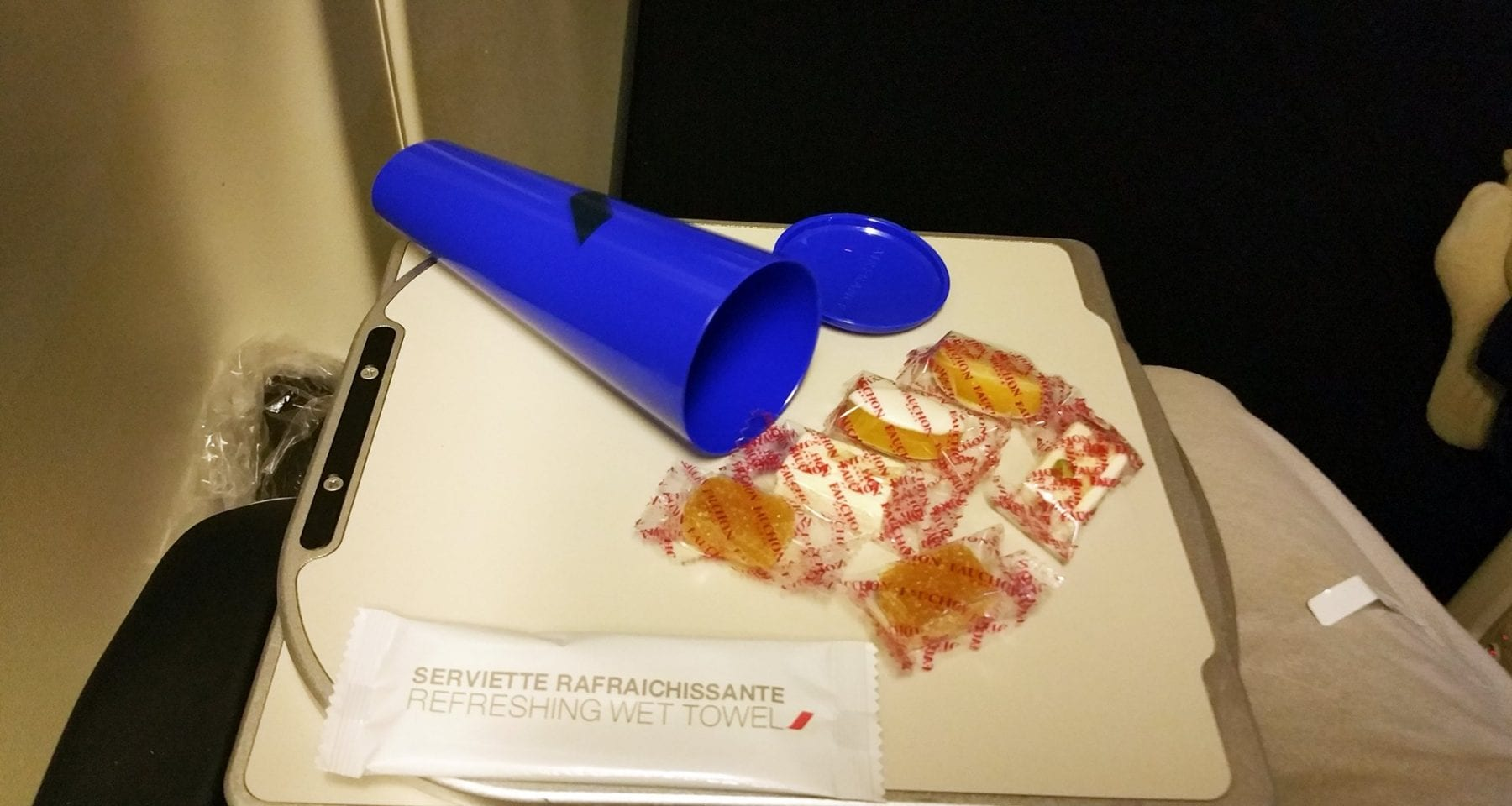 air france refresher towel and sweet cone
