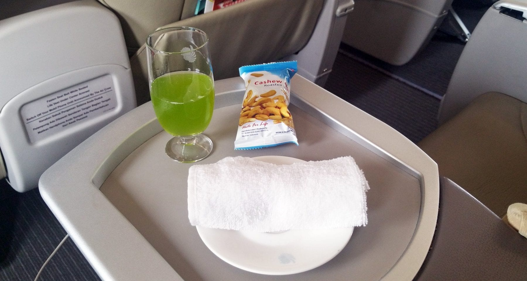 Batik Air business class inflight drink and towel