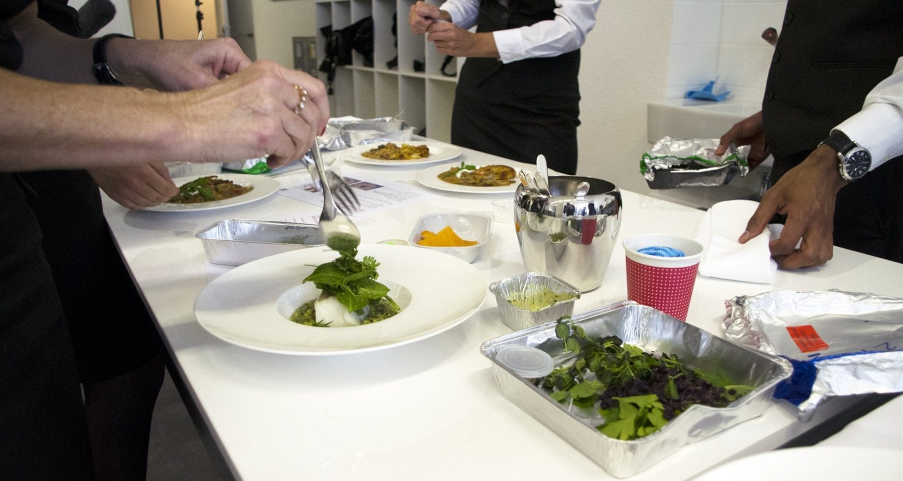 Swiss cabin crew plating up salads for first class guests